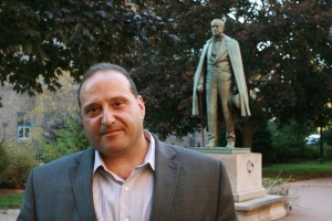 Attorney Joe Baldacci, at the Hannibal Hamlin statue in Bangor. Photo by Jeff Kirlin